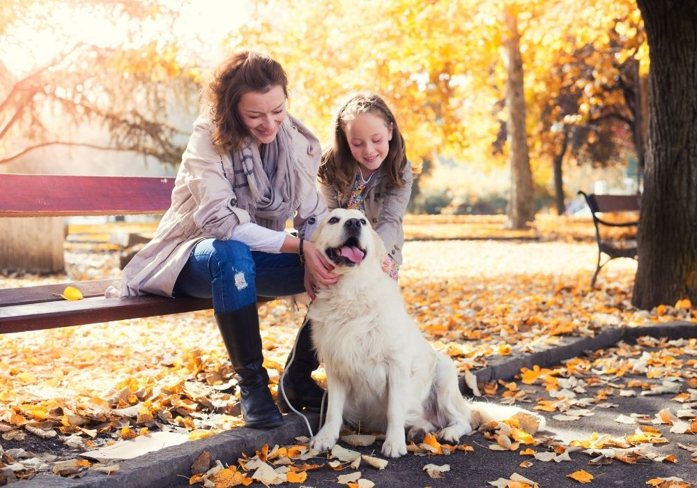 mother-daughter-dog-in-park